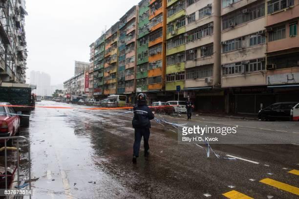 Police clear the street as typhoon Hato hits Hong Kong on August 23 2017 in Hong Kong Hong Kong Hong Kong's weather authorities raised Typhoon Hato...