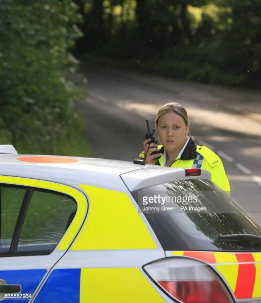 Police close a road in Sutton Courtenay near Abingdon in Oxfordshire close to where two people were today killed in a midair crash today when their...