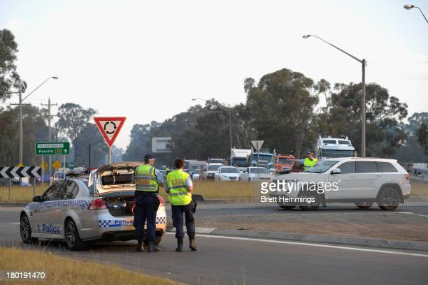 Police close roads as grass fires play havoc with peak hour traffic on Richmond Road at Richmond on September 10 2013 in Sydney Australia Seven...