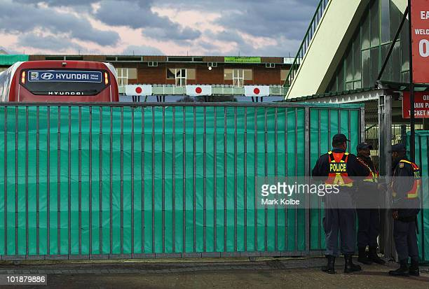 Police close the gates after the arrival of the team bus for a closed Japan training session at Outeniqua Stadium on June 8 2010 in George South...