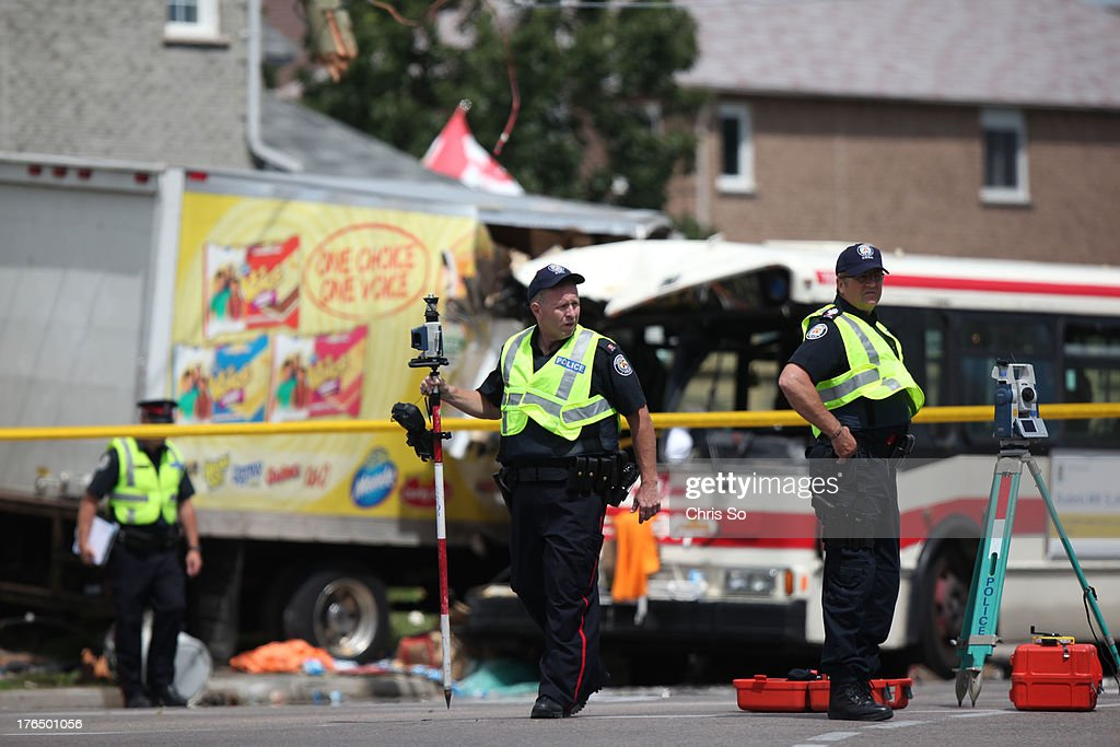 TORONTO, ON - AUGUST 13 - Police close the intersection of Middlefield Road and Steeles Avenue in Scarborough to investigate a crash fatality after a cube truck delivery van ploughed into an east bound TTC bus. Police say the fatality was a woman passenger about to exit the front of the bus.