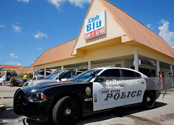 Police collect evidence outside of Club Blu night club where two people were killed and at least 15 wounded on July 25 2016 in Fort Myers Florida...