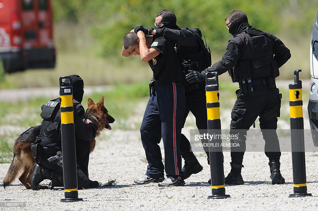 Police commandos from an anti-kidnapping unit, arrest a 'terrorist' during a drill at the Tom Jobim International Airport in Rio de Janeiro, Brazil, on January 13, 2012, ahead of the FIFA World Cup Brazil 2014 and the 2016 Olympic Games.