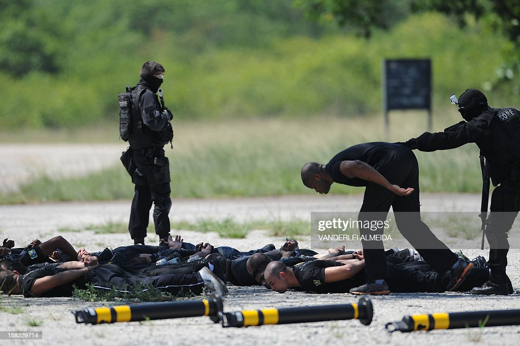 Police commandos from an anti-kidnapping unit, arrest and control a group of 'terrorists' during a drill at the Tom Jobim International Airport in Rio de Janeiro, Brazil, on January 13, 2012, ahead of the FIFA World Cup Brazil 2014 and the 2016 Olympic Games.