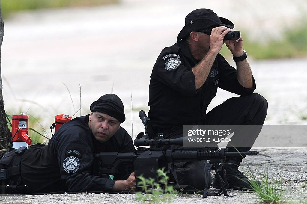 Police commandos from an anti-kidnapping unit carry out a drill at the Tom Jobim International Airport in Rio de Janeiro, Brazil, on january 13, 2012, ahead of the FIFA World Cup Brazil 2014 and the 2016 Olympic Games.