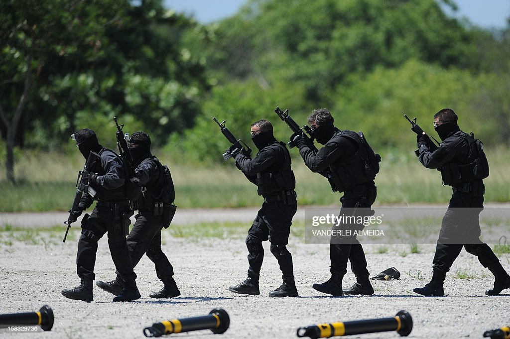 Police commandos from an anti-kidnapping unit conduct a drill at the Tom Jobim International Airport in Rio de Janeiro, Brazil, on January 13, 2012, ahead of the FIFA World Cup Brazil 2014 and the 2016 Olympic Games.