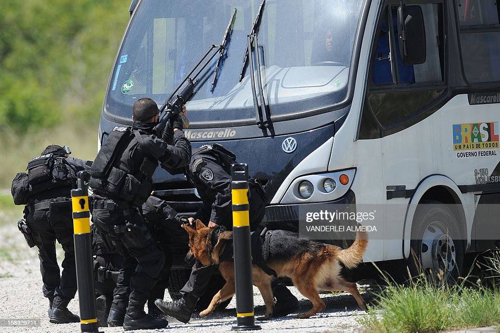 Police commandos from an anti-kidnapping unit, surround a bus with the 'victims' of the kidnapping during a drill at the Tom Jobim International Airport in Rio de Janeiro, Brazil, on January 13, 2012, ahead of the FIFA World Cup Brazil 2014 and the 2016 Olympic Games.