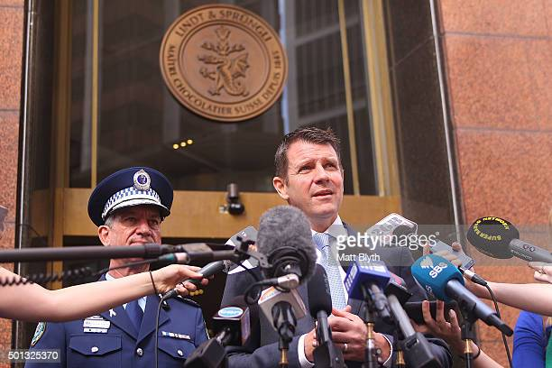 Police Commissioner Andrew Scipione and NSW Premier Mike Baird talk to the media outside the Lindt Cafe in Martin Place on December 15 2015 in Sydney...