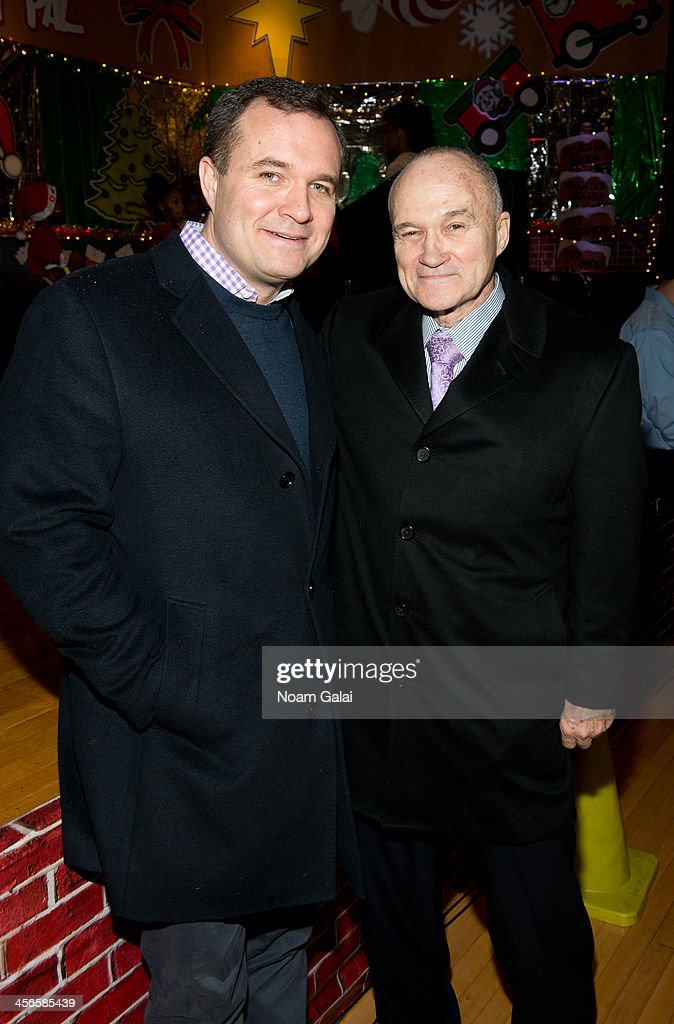 Police Commissioner Ray Kelly (R) and TV personality Greg Kelly attend the 2013 CitySightseeing New York holiday toy drive at PAL's Harlem Center on December 14, 2013 in New York City.