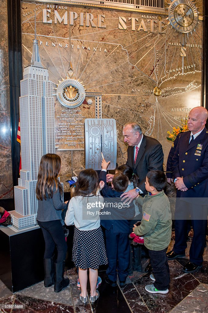 Police Commissioner William Bratton lights the Empire State Building with children of fallen police offcers in honor of Police Memorial Week on May 5, 2016 in New York City.