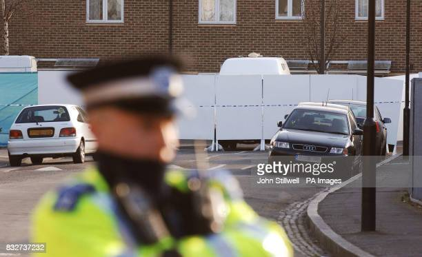 A police community support officer stands in Diamond Street in Peckham south east London where a 15yearold boy was shot dead inside his home today...