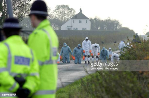 Police conduct a fingertip search at the scene close to the village of Askham Richard near York where officers are investigating a woman's body found...