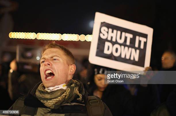 Police confront demonstrators outside the police station November 28 2014 in Ferguson Missouri The Ferguson area has been struggling to return to...