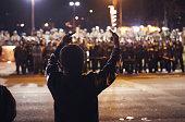 Police confront demonstrators outside the police station November 28 2014 in Ferguson Missouri The Ferguson area has been struggling to return to...