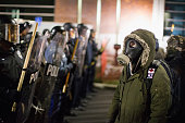 Police confront demonstrators protesting the shooting death of 18yearold Michael Brown outside the police station on November 19 2014 in Ferguson...