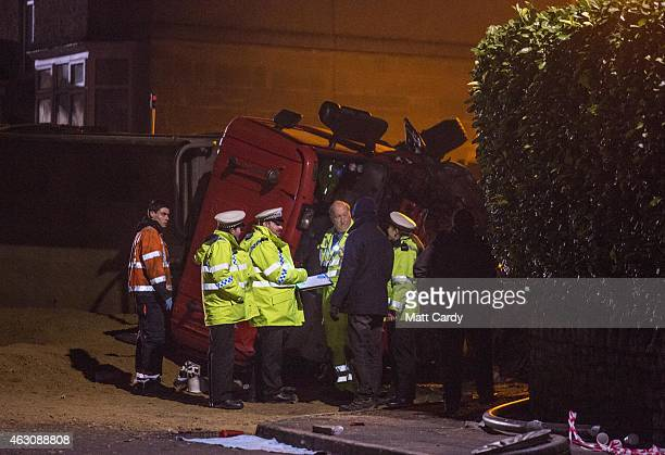 Police continue their investigations at the scene of a road traffic collision involving a lorry that has tipped onto its side on February 9 2015 in...