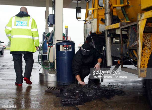 Police continue their search for missing 10yearold girls Holly Wells and Jessica Chapman as they examine the drains at the Q8 Garage in Soham Cambs...