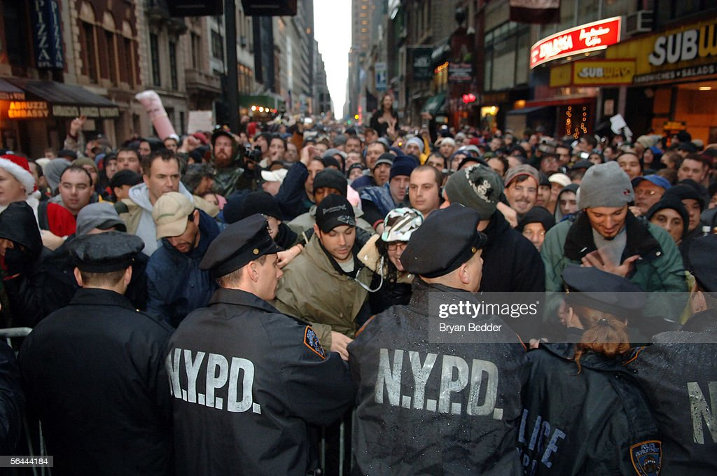 Police control a crowd of Howard Stern fans during the last WXRK 'Howard Stern Show' December 16, 2005 in New York City.