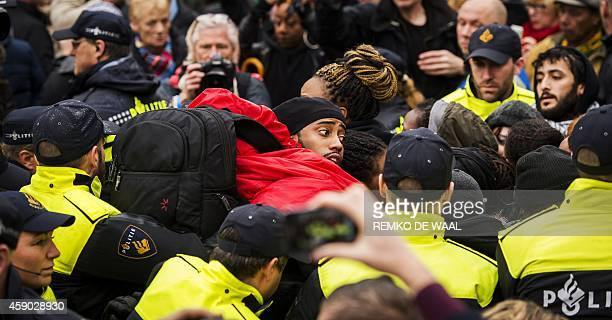 Police control antiBlack Peter demonstrators in Gouda on November 15 as the historic city welcomes Sinterklaas the Dutch version of Santa Claus and...