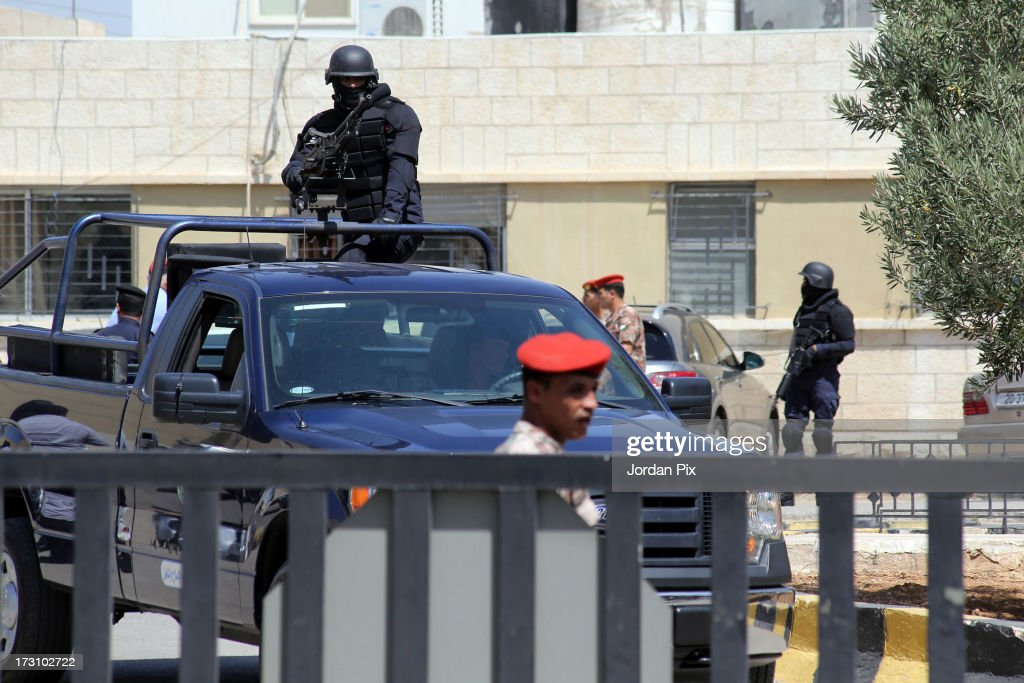 A police convoy carrying terror suspect Abu Qatada is driven towards the Jordanian State Security Court on July 7, 2013 in Amman, Jordan. Hardline Islamist cleric Abu Qatada arrived in Jordan earlier today after being deported from the UK to face terrorism charges in his home country.
