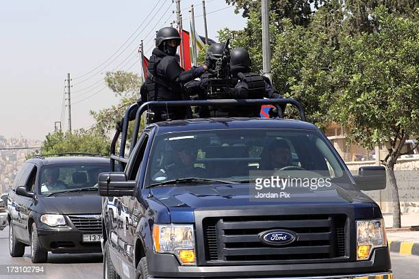 A police convoy carrying terror suspect Abu Qatada is driven towards the Jordanian State Security Court on July 7 2013 in Amman Jordan Hardline...