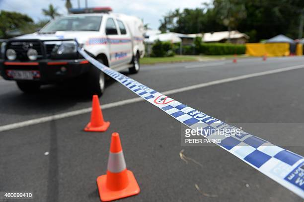 Police corden off the scene on December 20 2014 where eight children ranging from babies to teenagers were found dead in a house in the northern...
