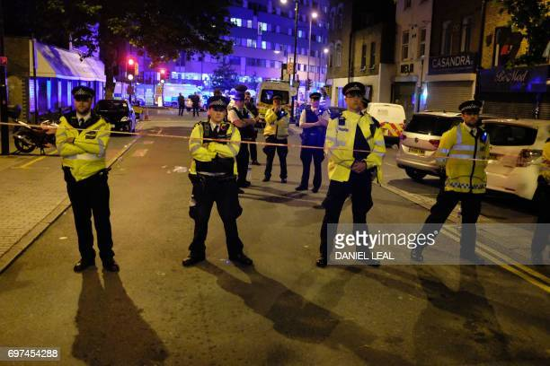 Police cordon off a street in the Finsbury Park area of north London after a vehichle hit pedestrians on June 19 2017 One person has been arrested...