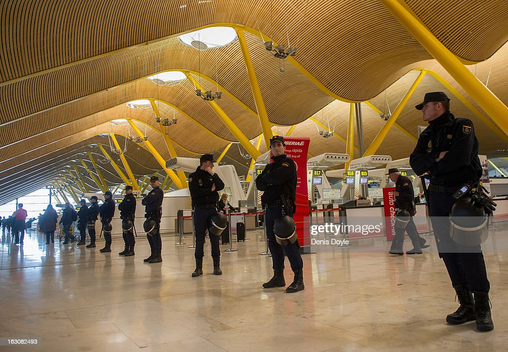 Police cordon off the check-in area of Barajas airport during a strike by Iberia Airlines workers on March 4, 2013 in Madrid, Spain. Iberia workers have begun the second round of five day strikes in protest at plans by holding company IAG (International Consolidated Airlines Group), formed by the 2011 merger of Iberia and British Airways, to implement redundancies and pay cuts across the troubled Spanish airline. The strike is estimated to cause the cancelling almost 1,300 flights this week, with a final round of five day strikes planned for March 18 to 22.