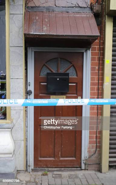 Police cordon off the entrance to a flat above Shiraz Restaurant in Hagley Road Birmingham which was raided by antiterror police in connection with...
