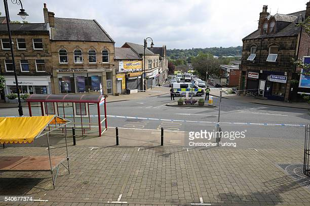 Police cordon off the scene after Jo Cox Labour MP for Batley and Spen was shot and stabbed by an attacker at her constituicency on June 16 2016 in...