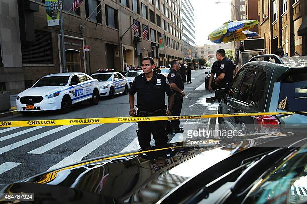 Police cordon off the scene in lower Manhattan where two people were shot at the Federal Immigration Court on August 21 2015 in New York City One man...