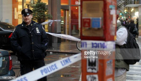 Police cordon off the scene of a fatal shooting at 202 West 58th Street in Manhattan on December 10 2012 in New York City The victim identified as a...