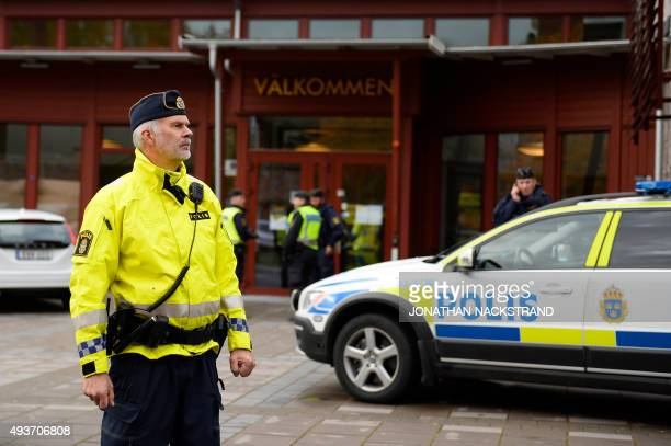Police cordon off the scene of a primary and middle school in Trollhattan southwestern Sweden on October 22 where a masked man armed with a sword...