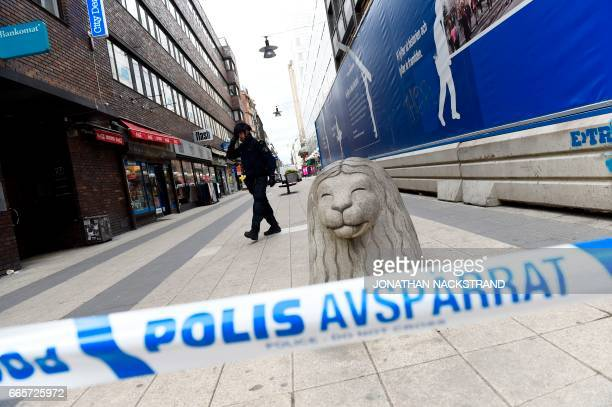 Police cordon off the scene where a truck crashed into the Ahlens department store at Drottninggatan in central Stockholm April 7 2017 PHOTO /...