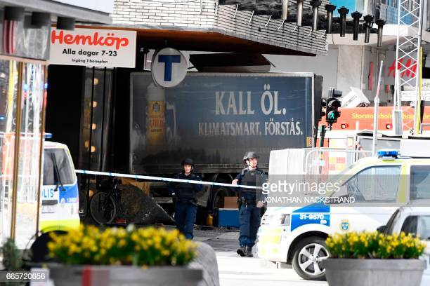 Police cordon off the truck which crashed into the Ahlens department store at Drottninggatan in central Stockholm April 7 2017 PHOTO / Jonathan...