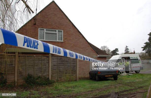 Police cordon tape and a police van are seen outside a house on Wellington Crecent in Baughurst Hampshire where explosive devices are believed to...