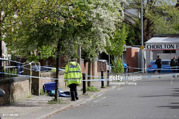 Police cordon tape secures the scene in Cranbourne Rd ChorltoncumHardy where exRoyal Navy officer Michael Samwell was fatally injured as he...