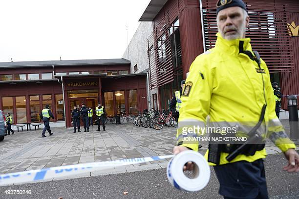 Police cordon the scene of the primary and middle school Kronan in Trollhattan southwestern Sweden on October 22 where a masked man armed with a...