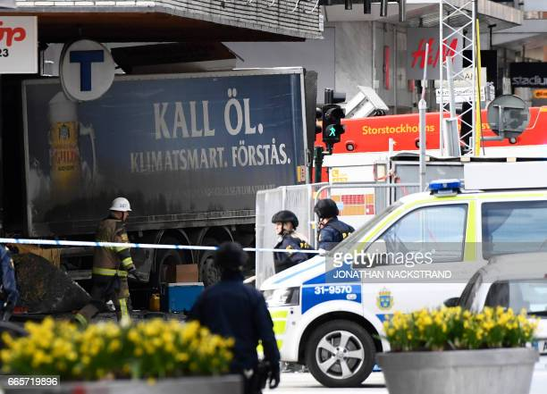 Police cordons the truck which crashed into the Ahlens department store at Drottninggatan in central Stockholm April 7 2017 PHOTO / Jonathan...