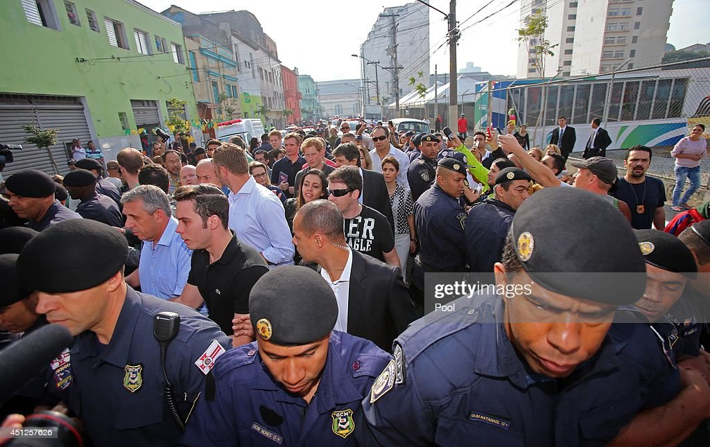 Police create a cordon to protect Prince Harry as he visits the Open Arms project which helps reduce crime and drug abuse in 'Cracolandia', an extremely deprived area of Sao Paulo with a high concentration of crack addicts on June 26, 2014 in Sao Paulo Brazil. Crack in Sao Paulo costs just 80 UK pence for a rock of the drug. Prince Harry is on a four day tour of Brazil that will be followed by two days in Chile.
