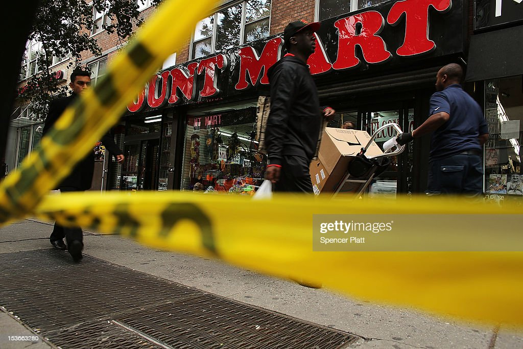 Police crime scene tape is placed near where the body of Michael Jones, a youth soccer coach, was found early Sunday morning outside the Levi's store on October 8, 2012 in New York City. Emergency responders found the 25-year-old native of Liverpool, England, laying in a pool of blood with numerous stab wounds to his neck and torso and was soon pronounced dead. Jones was a part-time coach with the New York Red Bulls' youth soccer team and lived in Westchester County. Reportedly, Jones can be seen in surveillance video arguing with a man before the attack. While police are looking for the suspect, no arrests have been made.