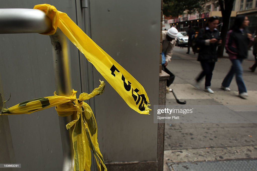 Police crime scene tape is placed near where the body of Michael Jones, a youth soccer coach, was found early Sunday morning outside the Levi's store on October 8, 2012 in New York City. Emergency responders found the 25-year-old native of Tarleton, England, laying in a pool of blood with numerous stab wounds to his neck and torso and was soon pronounced dead. Jones was a part-time coach with the New York Red Bulls' youth soccer team and lived in Westchester County. Reportedly, Jones can be seen in surveillance video arguing with a man before the attack. While police are looking for the suspect, no arrests have been made.