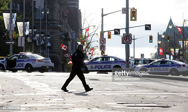 Police cruisers line Wellington Street near Parliament Hil on October 22 2014 in Ottawa Canada At least one gunman shot and killed a Canadian soldier...
