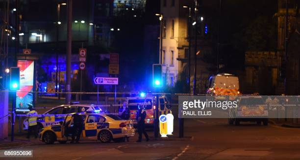 Police deploy at scene of a reported explosion during a concert in Manchester England on May 23 2017 British police said early May 23 there were 'a...