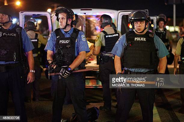 Police deployed during a civil disobedience action on August 10 2015 on West Florissant Avenue in Ferguson Missouri The night ended with over 10...