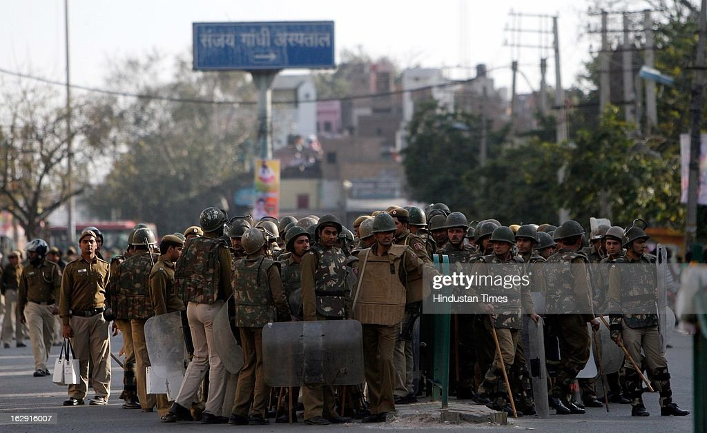Police deployment outside Sanjay Gandhi hospital after angry mob ransacked the hospital and police vehicle during a protest after an eight-year-old girl, student of Class 2, was allegedly raped inside the premises of a North Delhi Municipal Corporation school at Mangolpuri Area on March 1, 2013 in New Delhi, India.