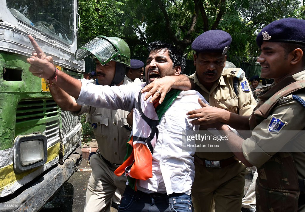 Police detain Delhi BJP party workers during the protest demanding an apology from Sonia Gandhi and her party leaders on their statements over the Batla House encounter issue at Congress Headquarter on May 30, 2016 in New Delhi, India. BJP has latched onto an IS video where one of the men claimed that he was at Batla House when police had raided the premises and fled afterwards. Last week, Congress general secretary Digvijaya Singh had stoked a controversy after he dubbed the 2008 Batla House encounter as fake.