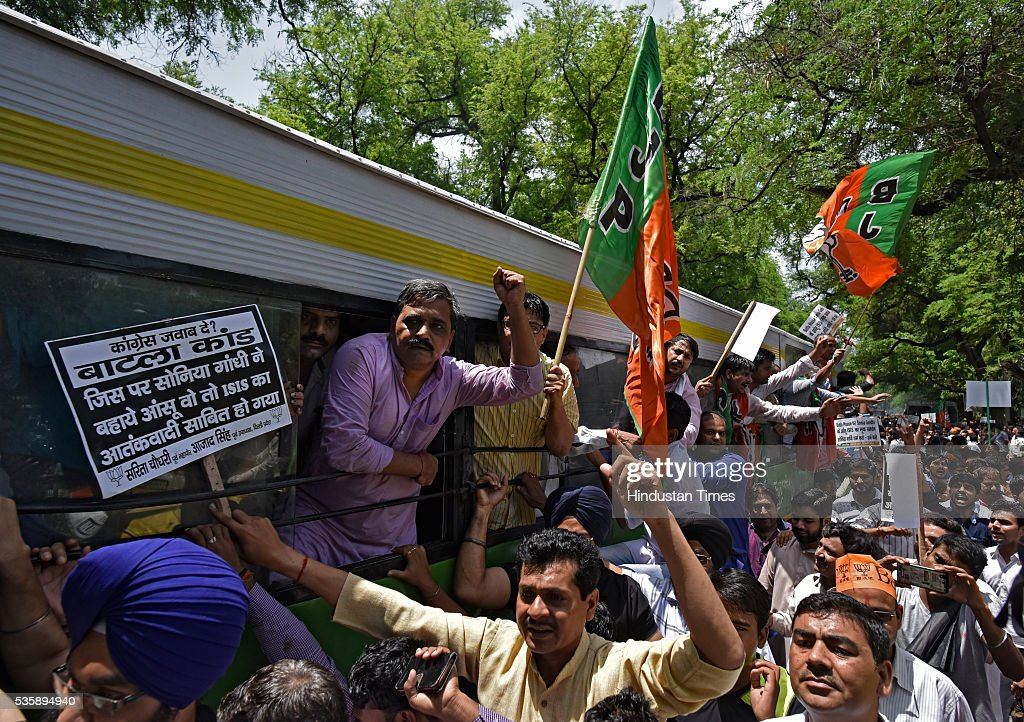 Police detain Delhi BJP President Satish Upadhyay with party workers during the protest demanding an apology from Sonia Gandhi and her party leaders on their statements over the Batla House encounter issue at Congress Headquarter on May 30, 2016 in New Delhi, India. BJP has latched onto an IS video where one of the men claimed that he was at Batla House when police had raided the premises and fled afterwards. Last week, Congress general secretary Digvijaya Singh had stoked a controversy after he dubbed the 2008 Batla House encounter as fake.