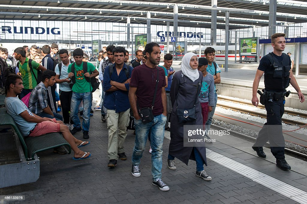 Police detain migrants arriving at Munich Hauptbahnhof main railway station without passports or valid visas on September 1, 2015 in Munich, Germany. Over a thousand migrants arrived in southern Germany by train in the last 24 hours, many of them who boarded trains in Budapest. According to police hundreds of migrants are arriving in southern Germany daily, either via people smugglers from Hungary along the A3 highway or via trains coming from Italy. Germany is expecting to receive 800,000 asylum-seeking migrants this year and is struggling to cope with the record number.