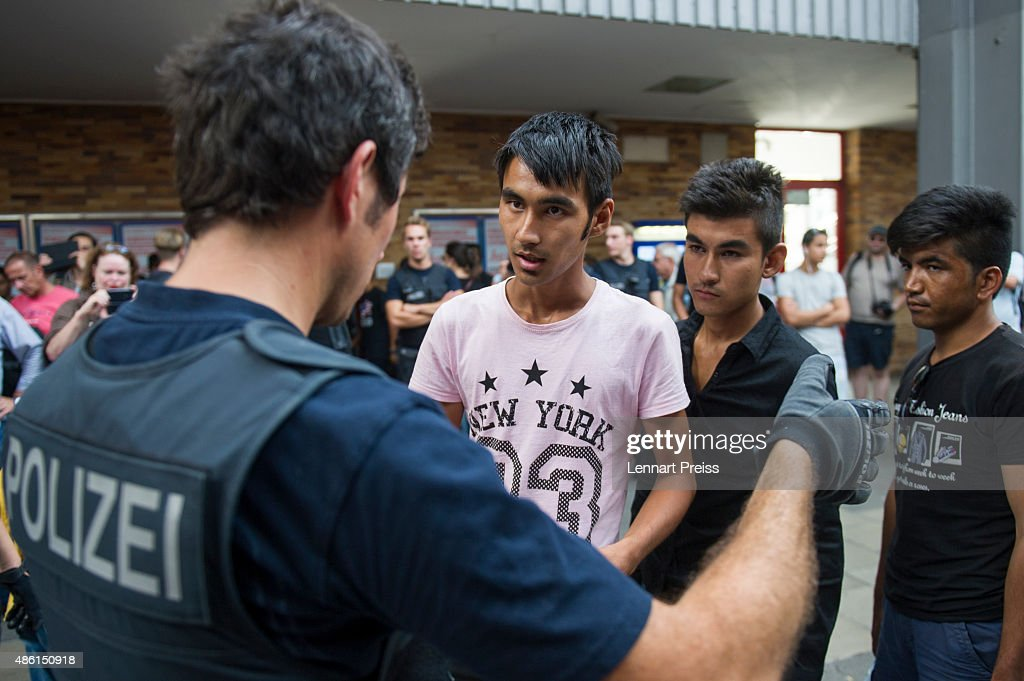 Police detain migrants who had arrived at Munich Hauptbahnhof main railway station and who had no passports or valid visas on September 1, 2015 in Munich, Germany. Over a thousand migrants arrived in southern Germany by train in the last 24 hours, many of them who boarded trains in Budapest. According to police hundreds of migrants are arriving in southern Germany daily, either via people smugglers from Hungary along the A3 highway or via trains coming from Italy. Germany is expecting to receive 800,000 asylum-seeking migrants this year and is struggling to cope with the record number.